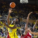 Michigan guard Tim Hardaway Jr. (10) shoots while defended by North Carolina State forward C.J. Leslie (5) during the second half of an NCAA college basketball game, Tuesday, Nov. 27, 2012, at Crisler Center in Ann Arbor, Mich. Michigan won 79-72. (AP Photo/Tony Ding)