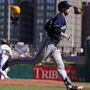 Milwaukee Brewers' Ryan Braun (8) rounds third, passing Pittsburgh Pirates closer Jason Grilli (39) after hitting a game-tying solo home run off Grilli during the ninth inning of a baseball game in Pittsburgh Sunday, April 20, 2014. The Brewers won in 14