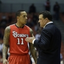 FILE - In this Jan. 5, 2013 file photo, St. John's head coach Steve Lavin talks with guard D'Angelo Harrison (11) during an NCAA college basketball game against Cincinnati, in Cincinnati. Harrison, the third-leading scorer in the Big East Conference, was suspended Friday, March 1, 2013 by St. John's for the rest of the season. Red Storm coach Steve Lavin made the announcement without giving a reason for the suspension, which includes postseason games. (AP Photo/Al Behrman, File)
