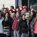 Relatives of those who died in the Hillsborough disaster sing 'You'll Never Walk Alone' outside outside the Hillsborough Inquest in Warrington, England, Tuesday April 26, 2016. The 96 Liverpool soccer fans who died in the Hillsborough Stadium