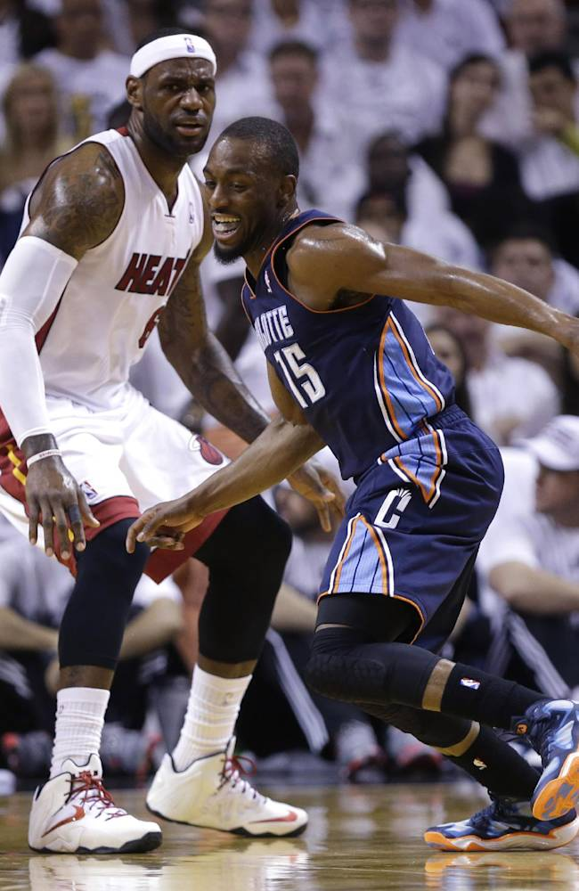 James, Wade lead Heat past Bobcats 99-88 in Game 1