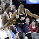 Oklahoma City Thunder forward Kevin Durant, right, works the ball in against Portland Trail Blazers guard Wesley Matthews during the second half of an NBA basketball game in Portland, Ore., Tuesday, Feb. 11, 2014. Durant scored 36 points as they beat the