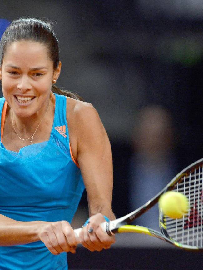 Serbia's Ana Ivanovic returns the ball to Russia's Maria Sharapova during their final match at the Porsche tennis Grand Prix in Stuttgart, Germany, Sunday, April 27, 2014