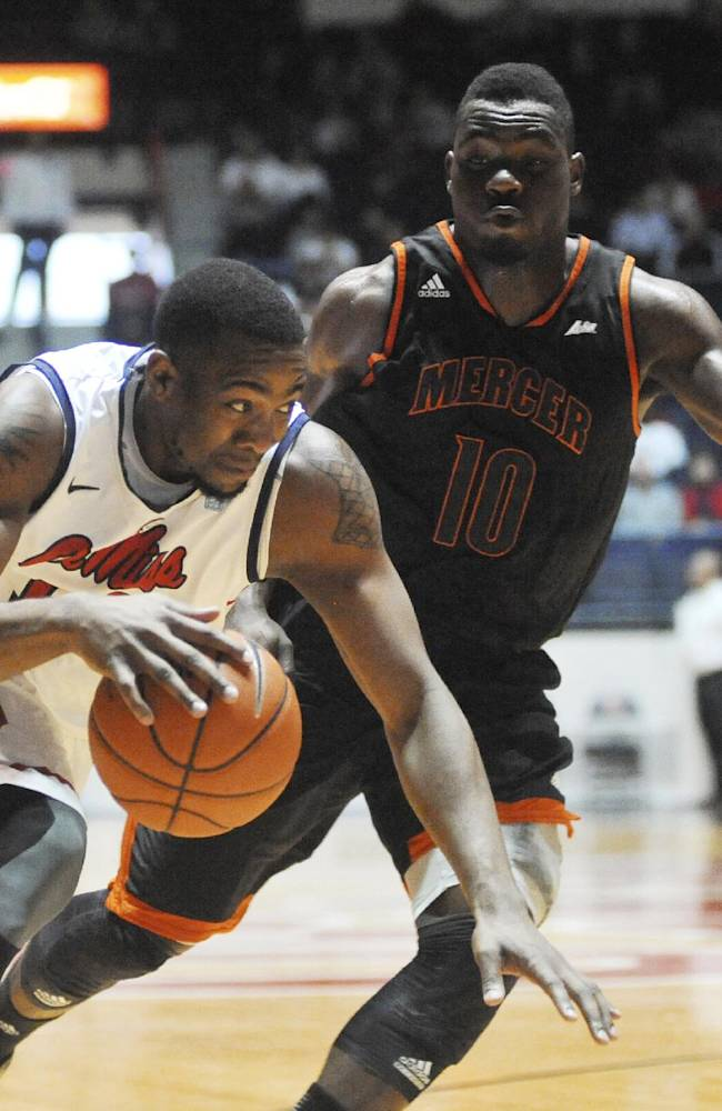 Mississippi's LaDarius White (10) drives against Mercer's Ike Nwamu (10) during an NCAA college basketball game Sunday, Dec. 22, 2013, in Oxford, Miss