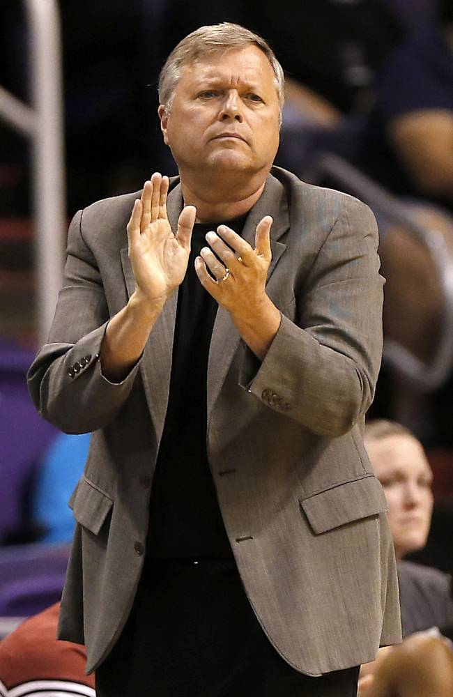 San Antonio Silver Stars coach Dan Hughes applauds his team during the first half of a WNBA basketball game against the Phoenix Mercury, Friday, Sept. 13, 2013, in Phoenix