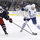 Columbus Blue Jackets' David Savard (58) tries to block the shot of Toronto Maple Leafs' James van Riemsdyk (21) in the first period of an NHL hockey game, Friday, Oct. 31, 2014, in Columbus, Ohio The Associated Press