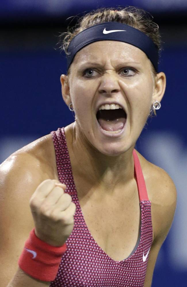 Lucie Safarova of the Czech Republic reacts after winning a match against Samantha Stosur of Australia during their third round match of the Pan Pacific Open tennis tournament in Tokyo, Wednesday, Sept. 25, 2013. Safarova  won 6-4, 6-4