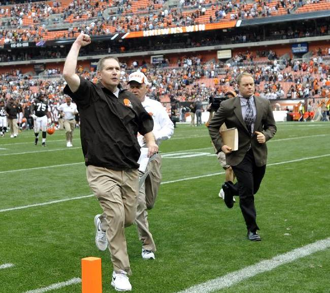 Cleveland Browns head coach Rob Chudzinski celebrates as he runs off the field following a 17-6 win over the Cincinnati Bengals in an NFL football game Sunday, Sept. 29, 2013, in Cleveland