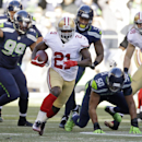 San Francisco 49ers running back Frank Gore (21) runs the ball in the first half of an NFL football game against the Seattle Seahawks, Sunday, Dec. 14, 2014, in Seattle The Associated Press