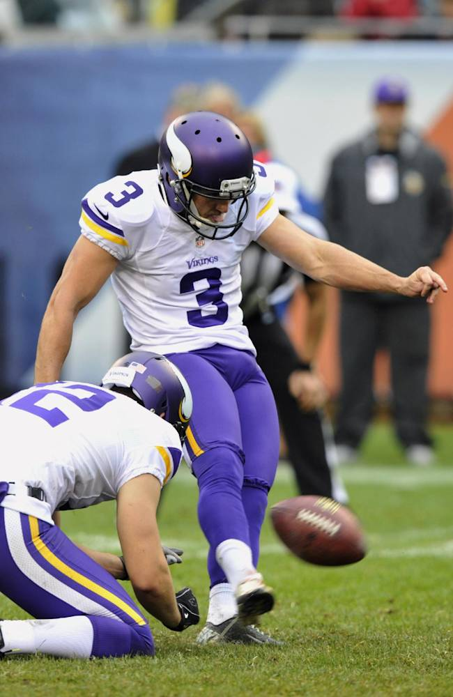 Minnesota Vikings' Blair Walsh (3) kicks a 28-yard field goal against the Chicago Bears during the second half of an NFL football game on Sunday, Sept. 15, 2013, in Chicago. Punter Jeff Locke (12) holds