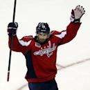 Washington Capitals' Troy Brouwer celebrates after scoring the winning goal against Boston Bruins in overtime of a preseason hockey game, Friday, Sept. 26, 2014, in Washington.The Capitals won 5-4. The Associated Press