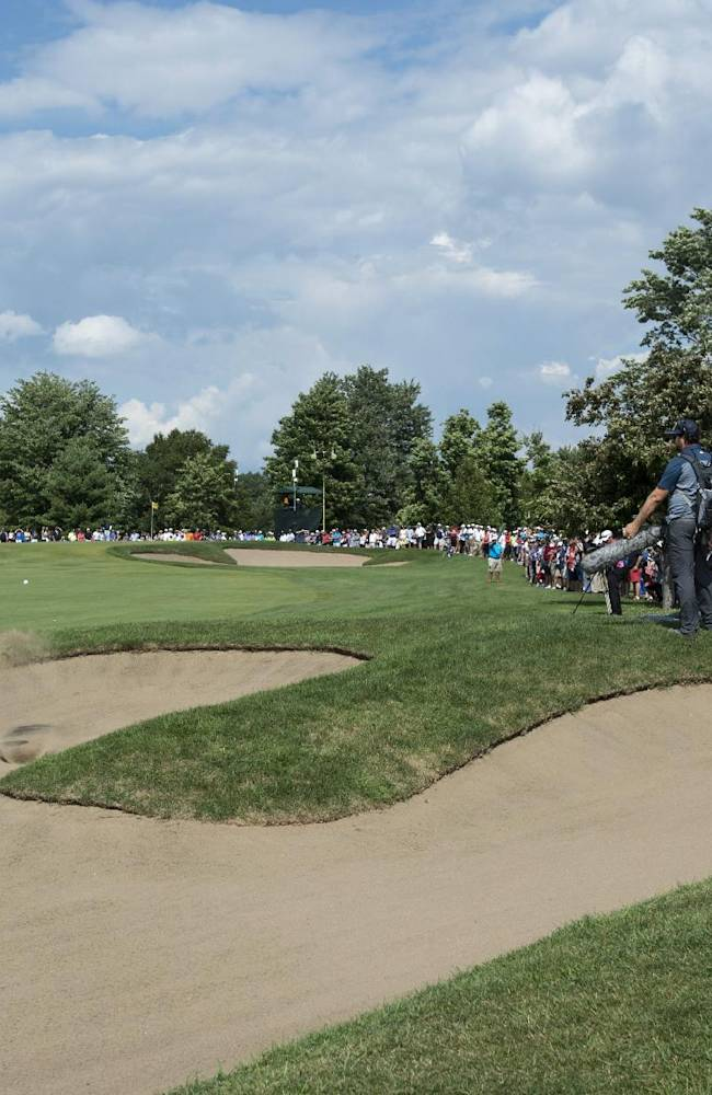 Tim Petrovic, of the United Sates, hits out of a bunker on the eighth hole during the third round of play at the Canadian Open golf championship in Montreal on Saturday, July 26, 2014