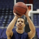 Syracuse guard Michael Carter-Williams shoots during practice for a regional semifinal game in the NCAA college basketball tournament, Wednesday, March 27, 2013, in Washington. Syracuse plays Indiana on Thursday. (AP Photo/Pablo Martinez Monsivais)