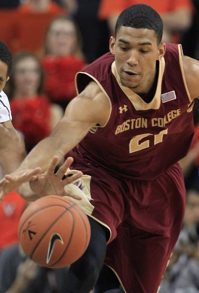 Virginia guard Malcolm Brogdon, left, and Boston College guard Olivier Hanlan (21) reach for a loose ball during the first half of an NCAA college basketball game in Charlottesville, Va., Wednesday, Feb. 5, 2014