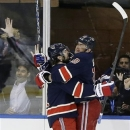 New York Rangers left wing Rick Nash (61) celebrates with New York Rangers right wing Marian Gaborik (10) after Gaborik scored a goal in the first period of their NHL hockey game at Madison Square Garden in New York, Wednesday, Jan. 23, 2013.  Gaborik scored two goals in the period. (AP Photo/Kathy Willens)