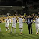 Dynamo Moscow's Yuri Zhirkov, Alexander Buttner, Aleksei Kozlov, Kevin Kuranyi, coach Stanislav Cherchesov and Dmitri Zhivoglyadov, from left to right, celebrate with supporters at the end of the Europa League group E soccer match between Dynamo Moscow a