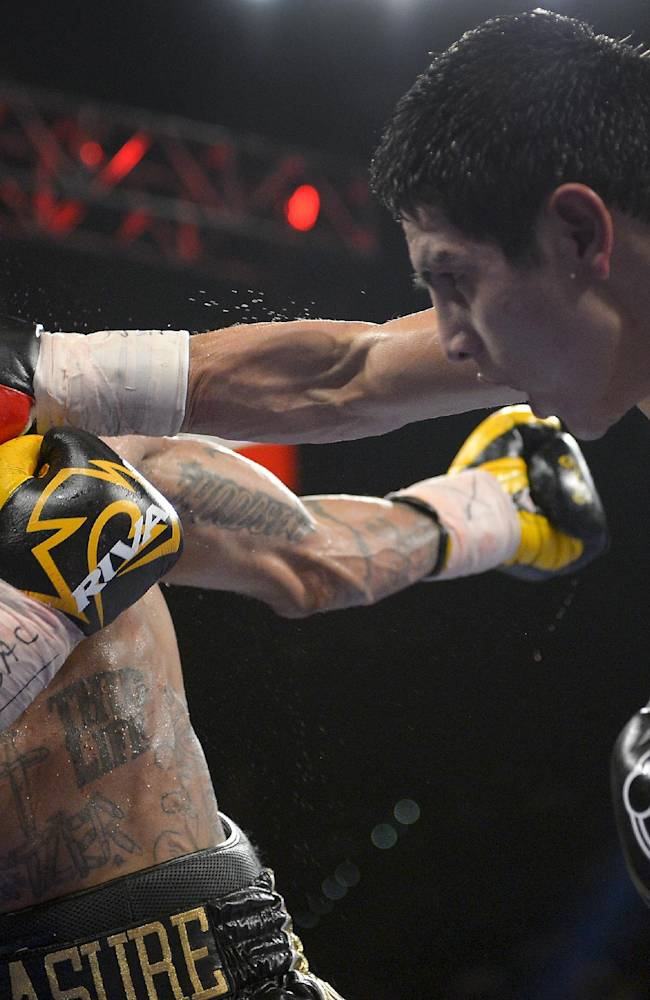 Pablo Cesar Cano, right, lands a punch against Ashley Theophane in the eighth round during a welterweight fight, Saturday, Sept. 14, 2013, in Las Vegas