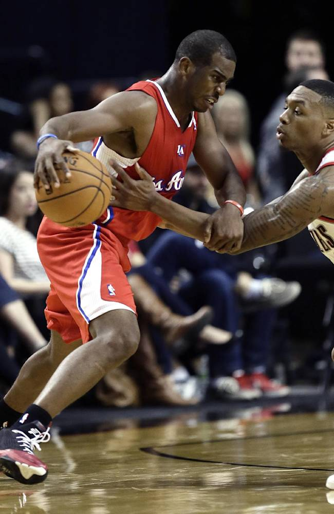Los Angeles Clippers guard Chris Paul, left, drives on Portland Trail Blazers guard Damian Lillard during the second half of an NBA preseason basketball game in Portland, Ore., Monday, Oct. 7, 2013. Paul scored 15 points as the Clippers won 89-81