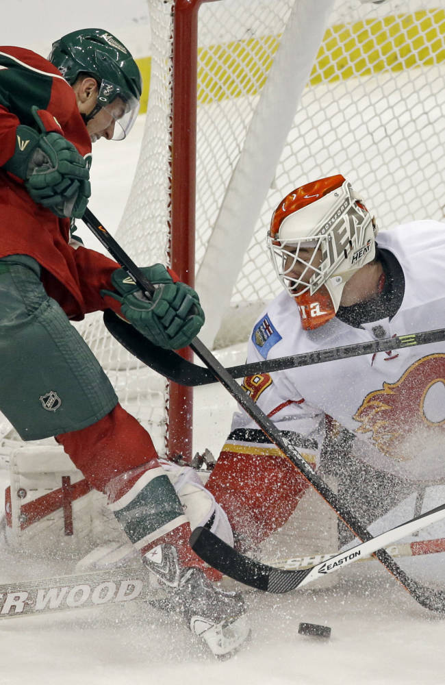 Parise, Harding lead Wild past Flames 5-1