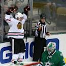 Chicago Blackhawks left wing Brandon Saad, left, celebrates a goal as Dallas Stars goalie Kari Lehtonen stands by the net in the second period of an NHL hockey game Tuesday, Dec. 10, 2013, in Dallas. (AP Photo/Sharon Ellman)