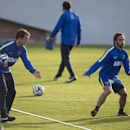 Rodolfo Arruabarrena, left, gives instructions near player Jose Fuenzalida, from Chile, during his first training session as new head coach for Argentina's Boca Juniors, in Buenos Aires, Argentina, Friday, Aug. 29, 2014. Arruabarrena became the new head c