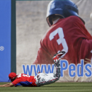 Philadelphia Phillies center fielder Ben Revere makes a diving catch for an out on a pop fly hit by Minnesota Twins' Josh Willingham in the fourth inning of an exhibition baseball game in Fort Myers, Fla., Sunday, March 9, 2014 The Associated Press