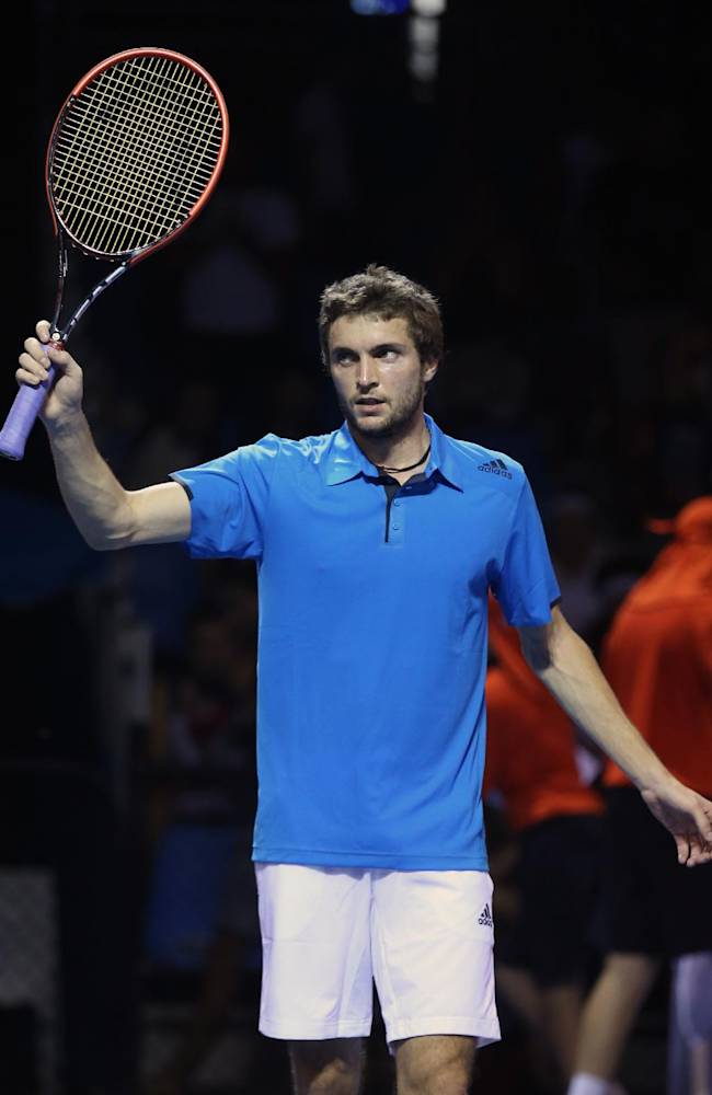 Gilles Simon of France waves to the crowd after defeating Marin Cilic of Croatia in their second round match at the Australian Open tennis championship in Melbourne, Australia, Friday, Jan. 17, 2014
