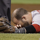 Boston Red Sox second baseman Dustin Pedroia is injured after colliding with Tampa Bay Rays' Logan Forsythe at second during the second inning of a baseball game Saturday, Aug. 30, 2014, in St. Petersburg, Fla. Pedroia left the game. (AP Photo/Chris O'Meara)
