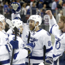 The Tampa Bay Lightning celebrate their 2-0 win over the New York Rangers in Game 7 of the Eastern Conference final during the NHL hockey Stanley Cup playoffs, Friday, May 29, 2015, in New York. (AP Photo/Frank Franklin)
