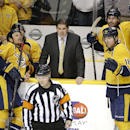 Nashville Predators head coach Peter Laviolette, center, yells to referee Graham Skiliter (24) after a goal by defenseman Seth Jones, not shown, was waved off in the second period of an NHL hockey game against the Edmonton Oilers Thursday, Nov. 27, 2014,