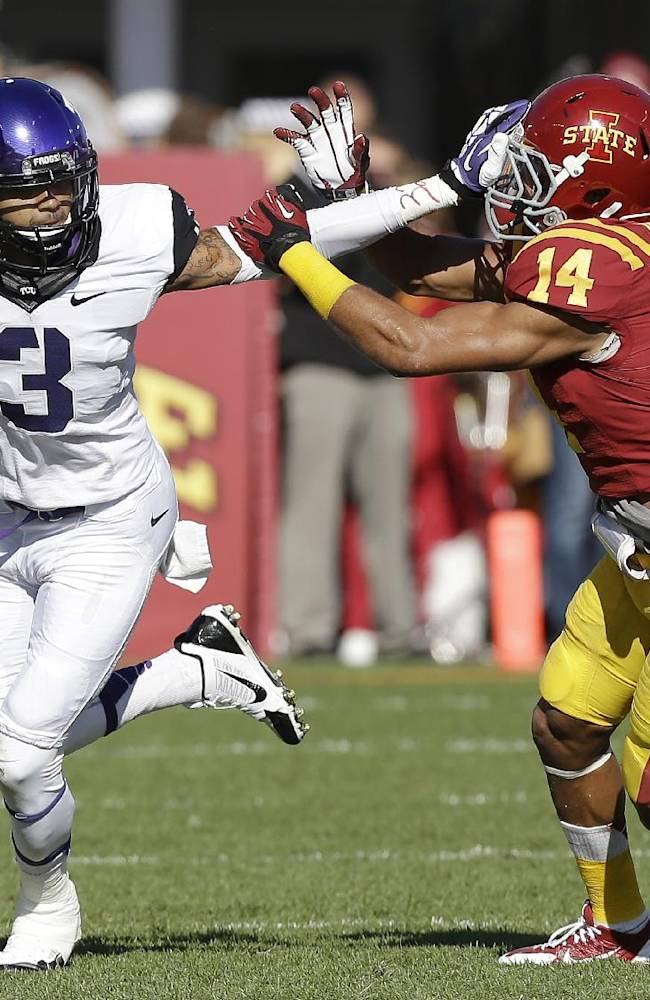 TCU wide receiver Brandon Carter (3) runs from Iowa State linebacker Jared Brackens after making a reception during the first half of an NCAA college football game, Saturday, Nov. 9, 2013, in Ames, Iowa