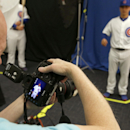 Chicago Cubs' Darwin Barney, right, poses for a photograph for team photographer Steve Green, left, during Cubs photo day, Monday, Feb. 24, 2014, in Mesa, Ariz The Associated Press