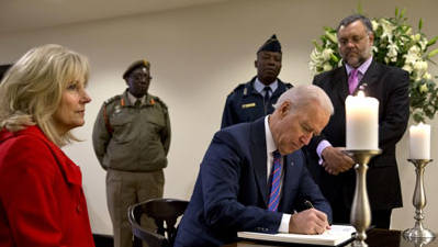 Raw: Biden Signs Mandela Condolence Book