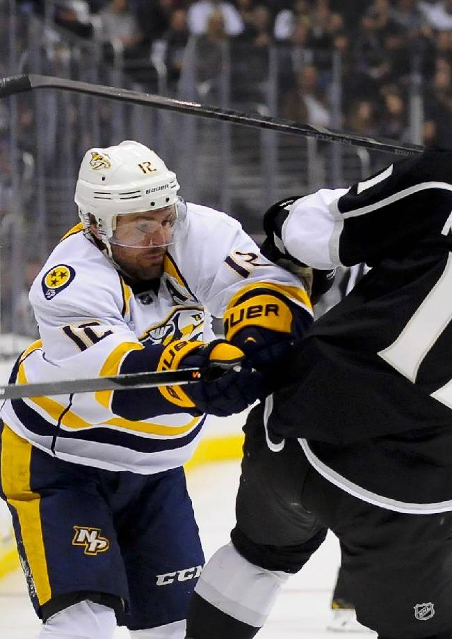 Nashville Predators center Mike Fisher (12) battles Los Angeles Kings center Anze Kopitar (11), of Slovenia, during the first period of their NHL hockey game, Saturday, Nov. 2, 2013, in Los Angeles