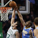 Denver Nuggets' Darrell Arthur (00) blocks a shot by Boston Celtics' Kris Humphries (43) in the second quarter of an NBA basketball game in Boston, Friday, Dec. 6, 2013 The Associated Press