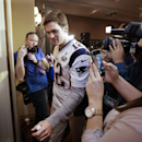 New England Patriots quarterback Tom Brady (12) leaves at the end of a news conference Wednesday, Jan. 28, 2015, in Chandler, Ariz. The Patriots play the Seattle Seahawks in NFL football Super Bowl XLIX Sunday, Feb. 1, in Phoenix The Associated Press