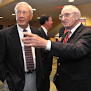 Pat Dye, left, is greated by retired Georgia coach Vince Dooley on Friday, Oct. 31, 2014, in Jacksonville, Fla. Dye and Ben Zambiasi, from the University of Georgia, and Louis Oliver and James Bates, from the University of Florida, were inducted into the