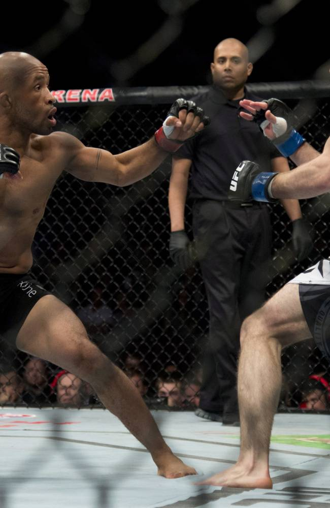 Demetrious Johnson, of the United States, left, fights with Ali Bagautinov, of Russia, during the flyweight bout at UFC 174 in Vancouver, British Columbia, Saturday, June, 14, 2014