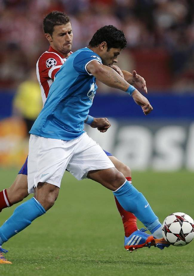 Atletico Madrid's Gabi duels for the ball with Zenit St. Petersburg Hulk during a Group G Champions League soccer match  at the Vicente Calderon stadium in in Madrid, Spain, Wednesday, Sept. 18, 2013