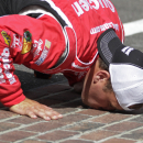 Sprint Cup Series driver Ryan Newman kisses the yard of bricks after winning the Brickyard 400 auto race at the Indianapolis Motor Speedway in Indianapolis, Sunday, July 28, 2013. (AP Photo/Robert Baker)