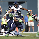 Seattle Seahawks' Marshawn Lynch (24) carries the ball against the Denver Broncos in the first half of an NFL football game, Sunday, Sept. 21, 2014, in Seattle The Associated Press