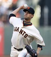 San Francisco Giants starting pitcher Ryan Vogelsong throws against the Minnesota Twins in the first inning of a baseball game Saturday, May 24, 2014, in San Francisco. (AP Photo/Tony Avelar)