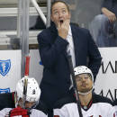 FILE - In this Oct. 28, 2014, file photo, New Jersey Devils head coach Peter DeBoer looks at the scoreboard during the first period of an NHL hockey game against the Pittsburgh Penguins in Pittsburgh. The Devils fired DeBoer on Friday, Dec. 26, 2014. (AP Photo/Gene J. Puskar, File)