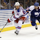 New York Rangers left wing Carl Hagelin (62) of Sweden looks to pass as New York Islanders defenseman Johnny Boychuk (55) chases him in the first period of an NHL hockey game in Uniondale, Tuesday, Jan. 27, 2015 The Associated Press
