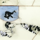 San Jose Sharks goalie Antti Niemi (31), of Finland, blocks a goal attempt against Los Angeles Kings center Mike Richards (10) as San Jose Sharks defenseman Justin Braun (61) and San Jose Sharks defenseman Brad Stuart (7) defends during the second period in Game 3 of their second-round NHL hockey Stanley Cup playoff series, Saturday, May 18, 2013, in San Jose, Calif. (AP Photo/Tony Avelar)