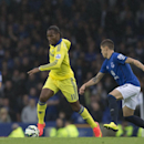 Chelsea's Didier Drogba, centre, keeps the ball from Everton's Aidan McGeady during their English Premier League soccer match at Goodison Park Stadium, Liverpool, England, Saturday Aug. 30, 2014