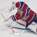 Montreal Canadiens goaltender Carey Price makes a save against Pittsburgh Penguins' Sidney Crosby during the third period of an NHL hockey game Saturday, Jan. 10, 2015, in Montreal The Associated Press