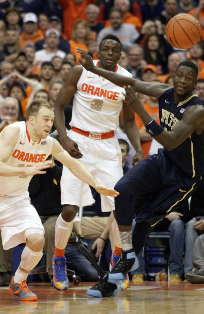 Syracuse Trevor Cooney, left, Jerami Grant, center, and Pittsburgh's Talib Zanna battle for a loose ball late in the second half of an NCAA college basketball game in Syracuse, N.Y., Saturday, Jan. 18, 2014. Syracuse won 59-54