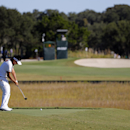 Danny Lee, of South Korea, hits his third tee shot off the drop zone on the 16th hole during the first round of the McGladrey Classic golf tournament on Thursday, Oct. 23, 2014, in St. Simons Island, Ga. (AP Photo/Stephen B. Morton)