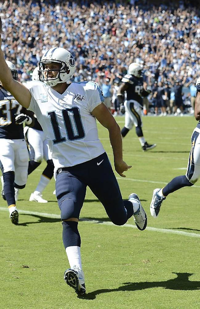 In this Sept. 22, 2013, file photo, Tennessee Titans quarterback Jake Locker (10) scores a touchdown on a 7-yard run against the San Diego Chargers in an NFL football game in Nashville, Tenn. Locker is coming off his best game yet in just his 14th NFL start, and he is one of only three quarterbacks yet to be intercepted